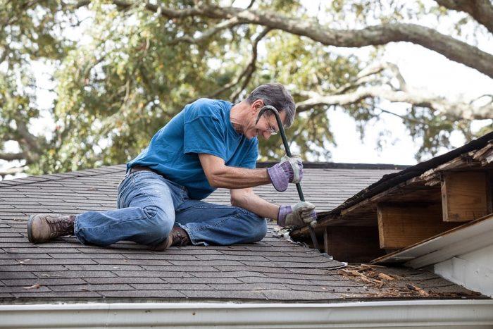 man removing Roof Flashing